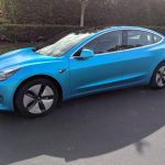 Tesla Model 3 - 3M Satin Ocean Shimmer fóliában:
